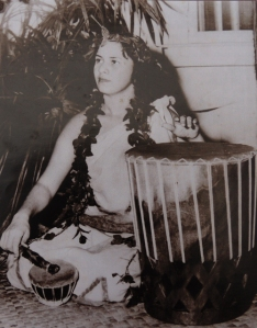 "Māiki Aiu performs during her 1948 'ūniki ceremony with a pahu drum made by Timothy Montgomery, which she lovingly referred to as ""My Baby Maiki."" The famed pahu disappeared from the Royal Hawaiian Hotel during the Aloha Week Festivities in the 1950s. Photo courtesy: Coline Aiu; originally published in ""Hula is Life"" written by Rita Ariyoshi."
