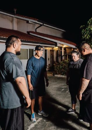"Coach Daniel Aipa (pictured second from left) begins each training session with the pule, ""Nā 'Aumākua,"" asking ancestors for strength, guidance and insight. Students may be challenged with self-doubt and frustration, and learn to work through those struggles in body and mind. In closing, they chant ""He Mū 'Oia,"" to clear the mind of negativity before the group departs. Photo by Josiah Patterson. All rights reserved."