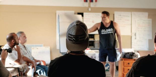 At a recent gathering at the Queen Lili'uokalani Children's Center in Wai'anae, Keawe'aimoku Koholokula Ph.D., speaks to men about the attributes and principles of Hawaiian male leadership. Photo by Josiah Patterson. All rights reserved.